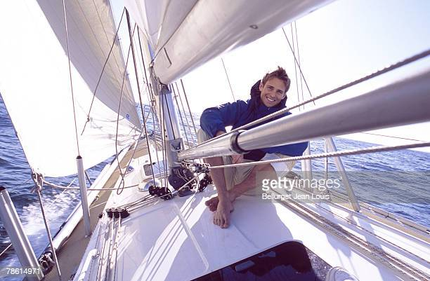 Men relaxing on sailboat
