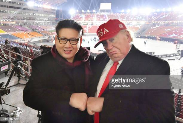 Men resembling US President Donald Trump and North Korean leader Kim Jong Un appear at the opening ceremony of the Pyeongchang Winter Olympics in...