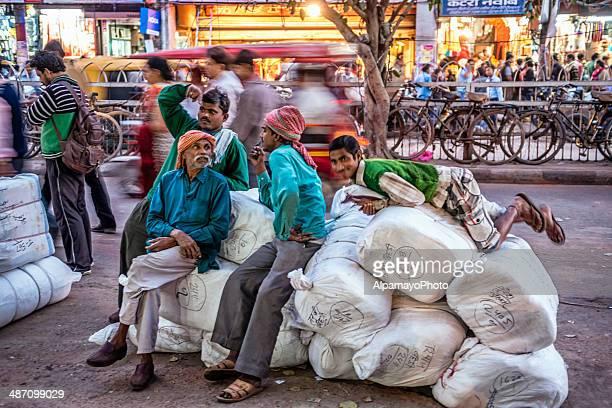 Men resting on their heavy load at Old Delhi market
