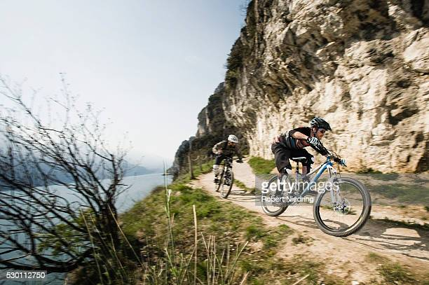 Men riding mountain bike at Lake Garda, Italy