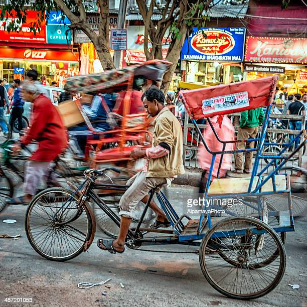 men riding their rickshaws at old delhi spice market - old delhi stock pictures, royalty-free photos & images