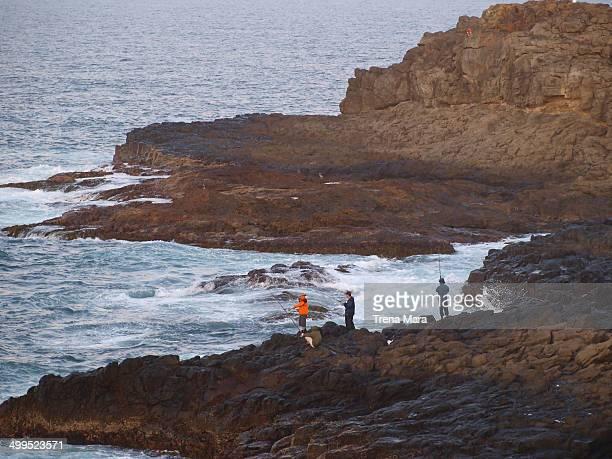 Men rock fishing,dangerous sport in Australia, 2009