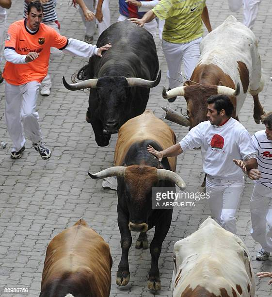 Men run with Miura fighting bull during the sixth run of the bulls of the San Fermin festival on July 12 in Pamplona northern Spain The festival is a...