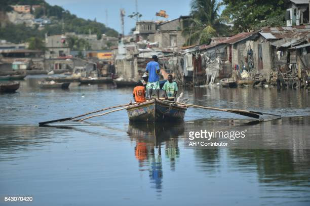 Men sail on Mapou Riverin Shadaa neighborhood in CapHaitien in the north of Haiti 240 km from PortauPrince ahead of Hurricane Irma on September 5...