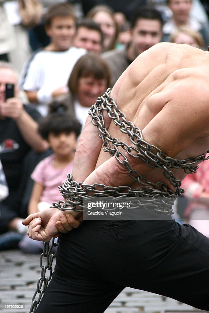 Men scaping in a street performance : Stock Photo