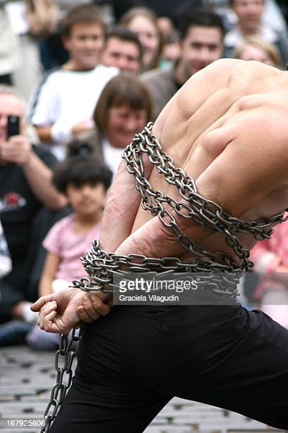 Men scaping in a street performance
