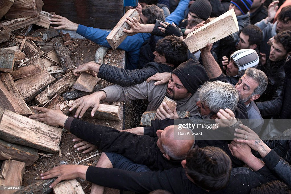 Men scramble for firewood after a truck brought five tonnes to the Idomeni refugee camp on the Greek-Macedonia border on March 06, 2016 in Idomeni, Greece. Doctors are warning that conditions at the camp are becoming dangerous for children, with medics dealing with a range of illnesses, including hypothermia. The transit camp at the border is becoming increasingly overcrowded as thousands of refugees continue to arrive from Athens and the Greek Islands. Macedonia's border with Greece remains 'open' but after allowing 580 refugees a day to cross into the country at the beginning of the week, the numbers passing have fallen dramatically with only a handful every day. According to local authorities approximately 12,000 refugees and migrants now remain stuck at the border as they wait to enter Macedonia to continue their journey North into Western Europe.