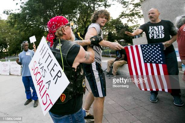 Men scuffle ahead of the Democratic presidential candidate debate in Detroit Michigan US on Wednesday July 31 2019 Hillary Clinton in 2016 was the...