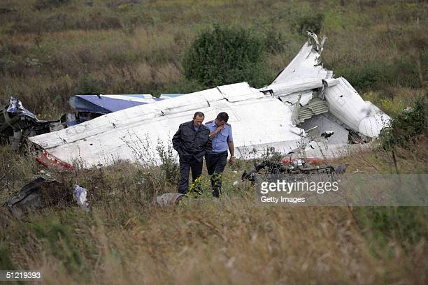 Men search for bodies of the victims from a Tupolev Tu154 passenger plane crash in a pasture August 25 2004 near Zelenovka village some 140 km from...