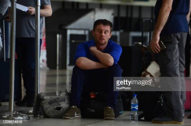 Men seat on his belongings waiting to be checked-in during an evacuation of EU citizens members includes Germany, France, Austria, Italy, Spain,...