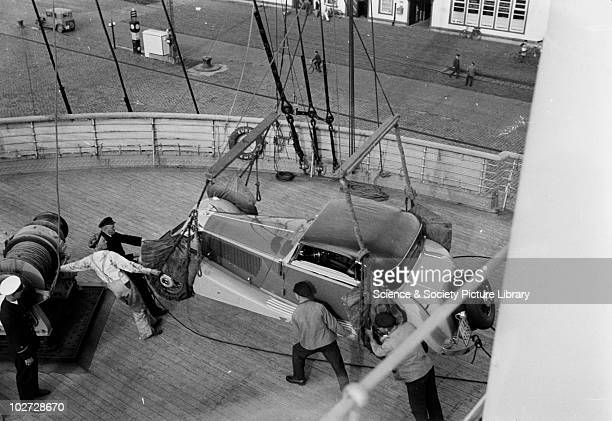 Men securing the Mercedes Benz car on deck. Photograph taken during unloading of Mercedes Benz cars from the ship the 'Europa'