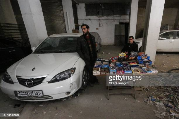 2 men seen selling snacks on a small table outside the underground shelter The residents of Arben have been hiding in underground shelters for 25...