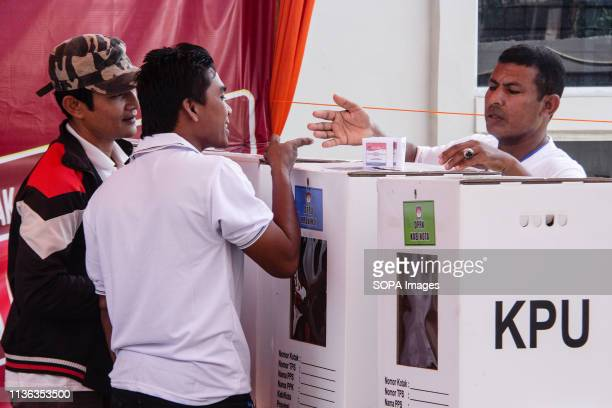 LHOKSEUMAWE ACEH INDONESIA Men seen talking to each other before casting their ballot during preelection drill for president vicepresidential...