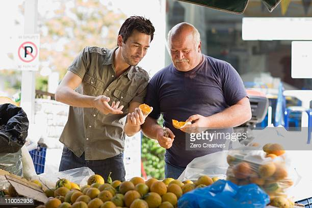 Men selling fruits