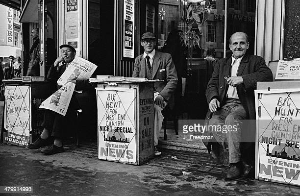 Men selling the 'Evening Standard' and 'Evening News' in London, England, 1969.