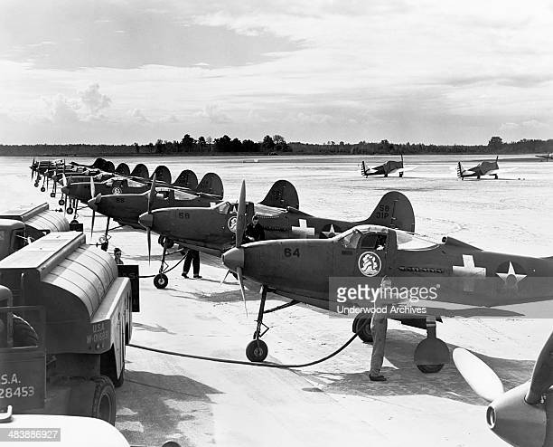 Men servicing Army Air Corp Bell P39 Airacobra fighter planes late 1930s