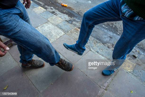 Men shake their feet instead of shaking hands amid coronavirus fears on March 16 2020 in New Delhi India The number of COVID19 cases continue to rise...