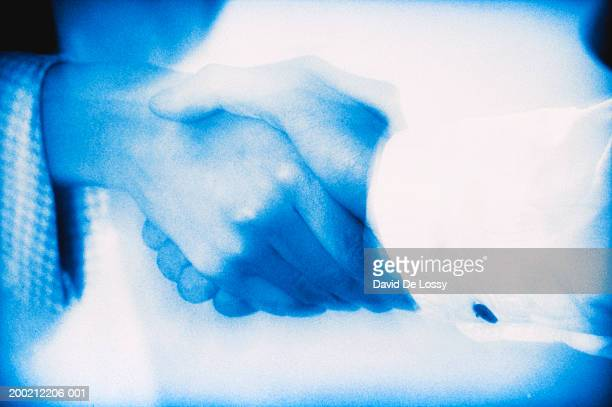 men shaking hand - cross processed stock pictures, royalty-free photos & images