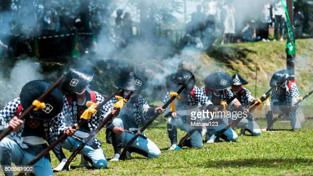 Men shooting antique gun for a traditional festival in Japan