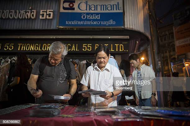 Men shop for DVDs at a roadside stall in Bangkok Thailand on Wednesday Feb 3 2016 Thailand is waiting for a new constitution waiting for the...