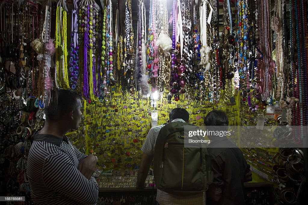 Men shop for jewelry in the Colaba area of Mumbai, India, on Tuesday, Nov. 6, 2012. Reserve Bank of India Governor Duvvuri Subbarao lowered the RBI's forecast for India's gross domestic product growth in the year through March to 5.8 percent, the slowest in almost a decade, from 6.5 percent. Photographer: Brent Lewin/Bloomberg via Getty Images