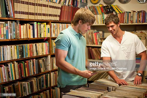 Men shopping together in thrift store