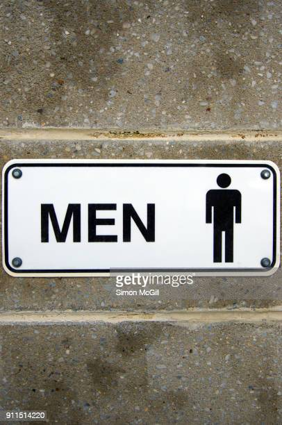 'Men' sign on the exterior wall of a public restroom in a public park