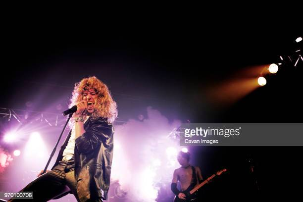 Men singing at rock concert