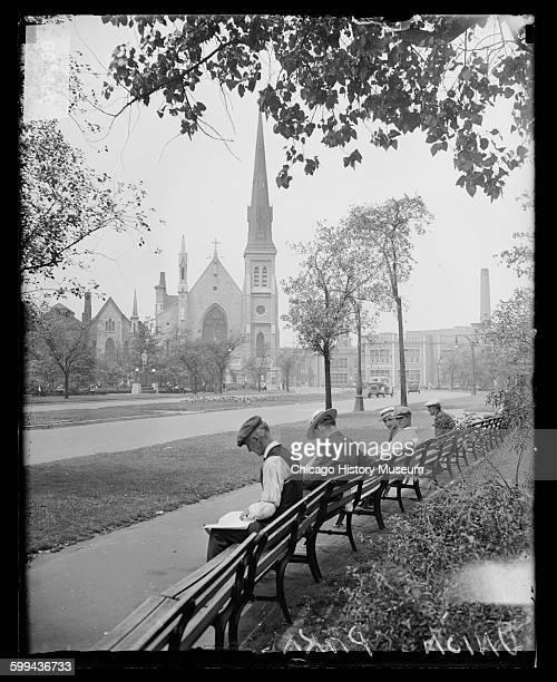 Men sitting near a church in Union Park Chicago Illinois 1929
