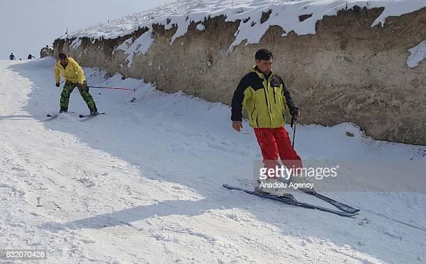 Men ski on Kabul Mountain Kabul Afghanistan on January 19 2017