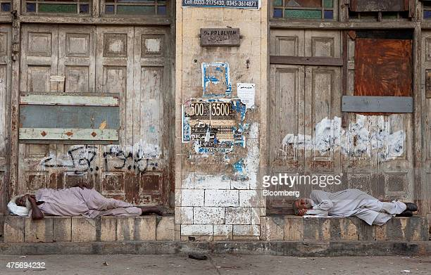Men sleep outside a building in Karachi Pakistan on Friday May 29 2015 Pakistan's budget is scheduled to be presented on June 5 Photographer Asim...