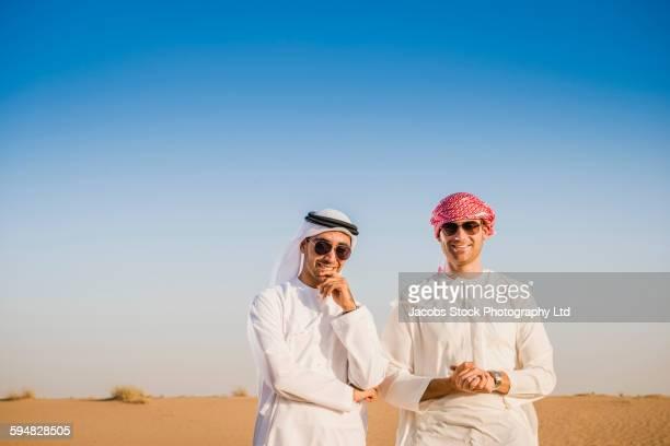 Men smiling in desert