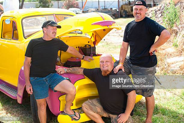 Men smiling with colorful car