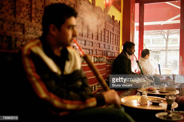 Men smoke shisha in a cafe on Edgeware road on March 15 2007 in London The shisha bars popular with the middle eastern communities of London's...