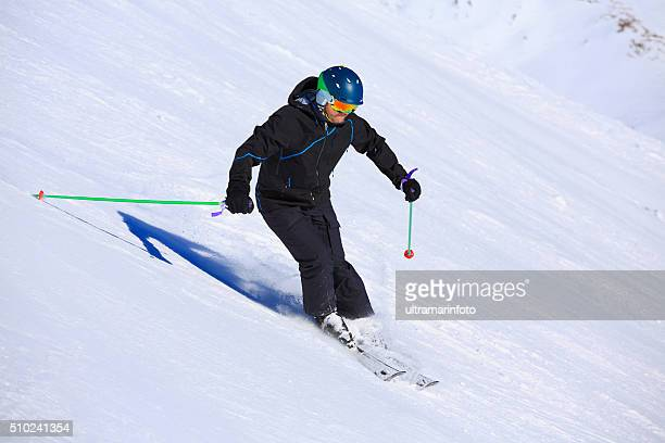 Men snow skier  skiing carving techniques at high speed