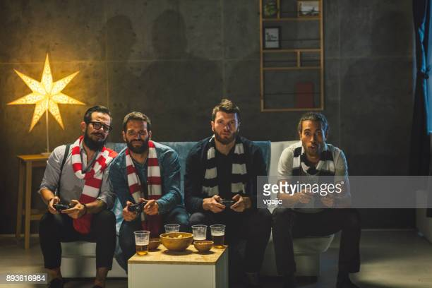 men socializing at home - playing video games - man cave stock pictures, royalty-free photos & images