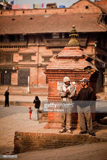 men socializing at nyatapola pagoda - merten snijders stock pictures, royalty-free photos & images