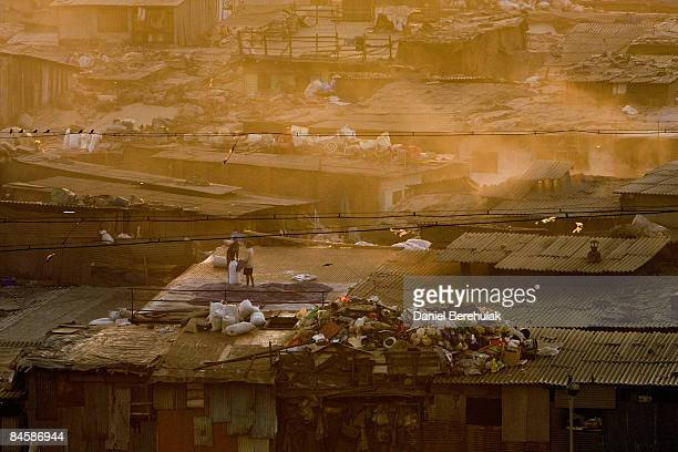 Men sort out items for recycling in the Dharavi slum on February 2 2009 in Mumbai India The redevelopment of asia's largest slum the Dharavi spanning...