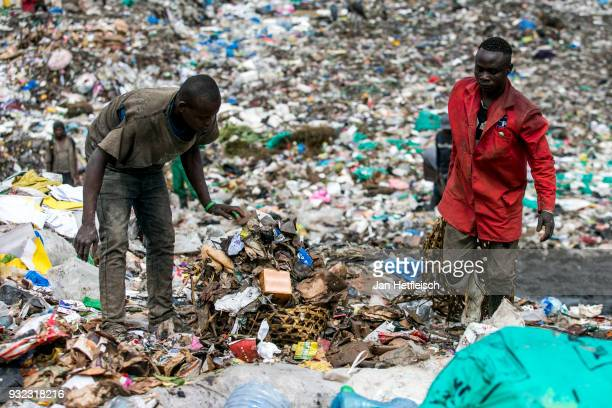 Men sort out paper and plastic at the Dandora rubbish dump on March 14 2018 in Nairobi Kenya The Dandora landfield is located 8 Kilometer east of the...