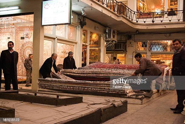 Men sorting carpets in Tehran's Grand Bazar