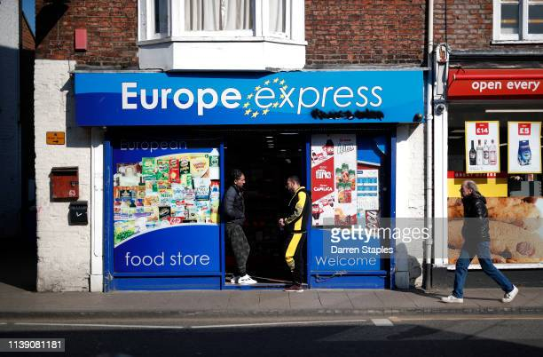 Men speak in the doorway of a grocery store on March 29 2019 in Boston England The town of Boston in Lincolnshire voted with a 75% majority to leave...