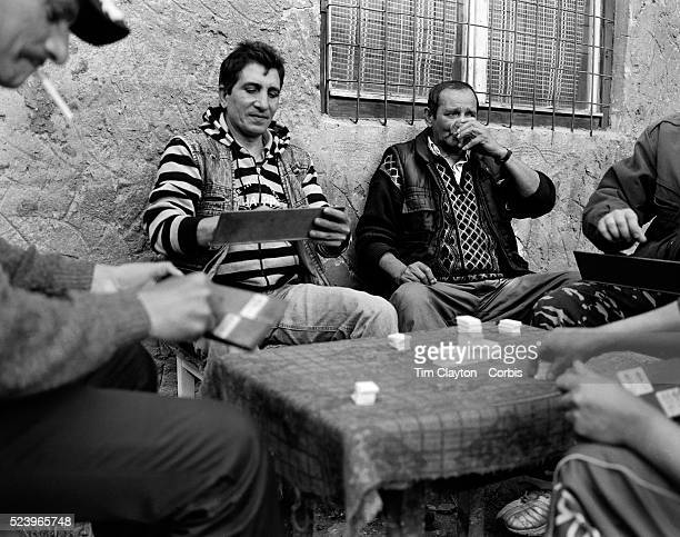 Men spend the afternoon playing a game for small wagers in a housing estate of Copsa Mica, Transylvania, Romania. The small industrial town deep in...