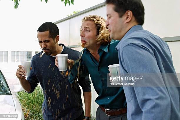 Men spitting coffee