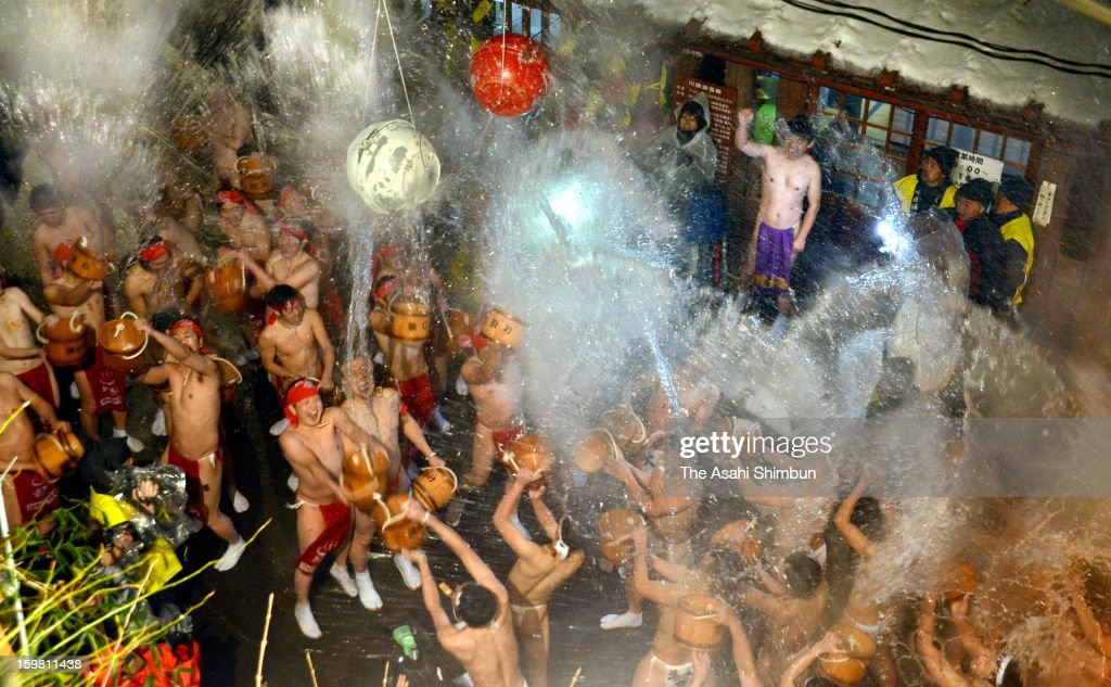 Men splash hot water each other during the Yukake Festival at Kawarayu Hot Spring district on January 20, 2013 in Naganohara, Gunma, Japan. 60 men wearing Japanese loincloths participated in the annual festival in sub-zero temperature.