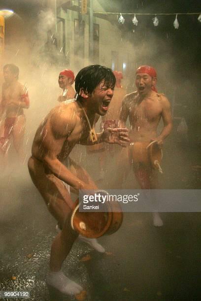 Men splash hot water each other during the Yukake Festival at Kawarayu hot spring district on January 20 2010 in Naganohara Gunma Japan 60 men...