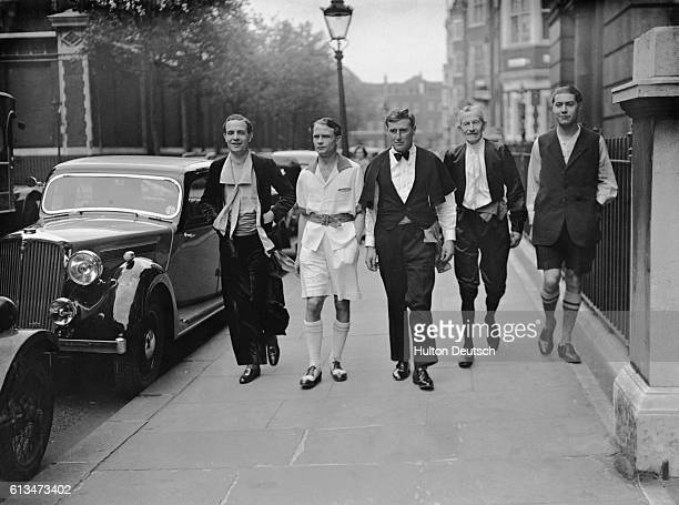 Men sporting entries in a prizegiving competition organized by the Men's Dress Reform Party stroll along Great Russell Street near King George's Hall...