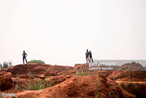 Men stand atop of the Nkanzala abandoned mine in Tshikapa in Democratic Republic of Congo's central Kasai region on July 29 2017 The flareup in the...