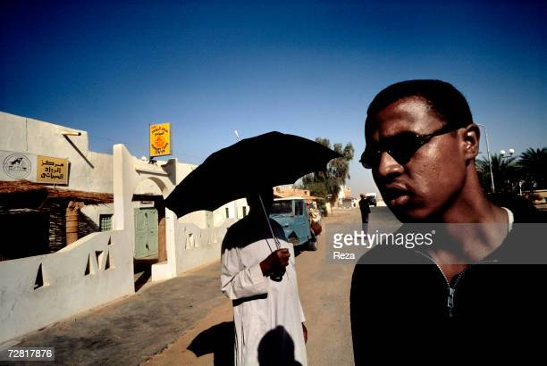 Men stand in the main street of the modern town April 2000 in Ghadames Libya