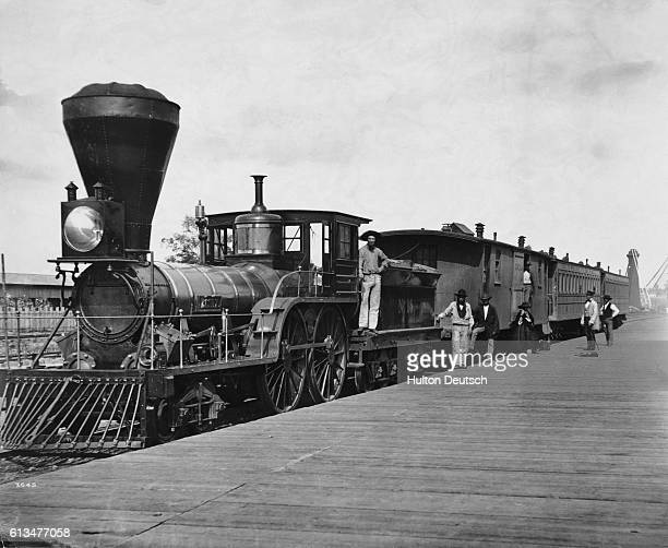 Men stand near a steam locomotive on the Great Western Railway The Great Western Railway is now known as the Canadian Pacific Railway