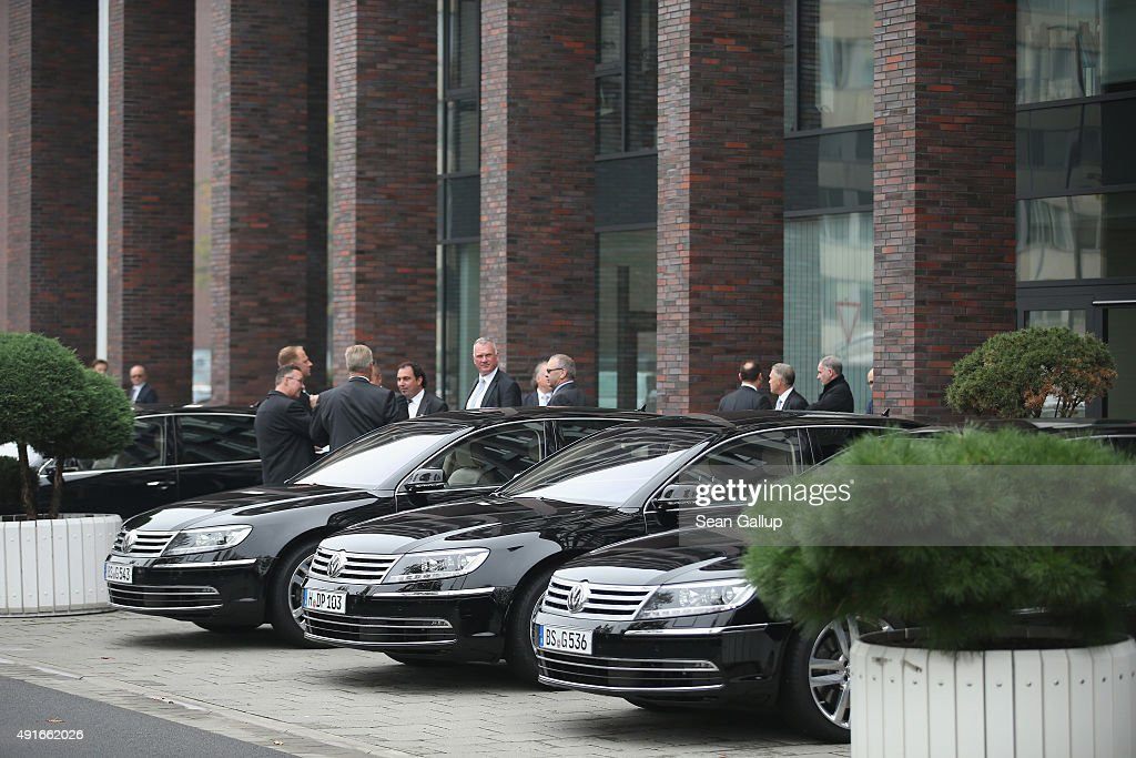 Men stand next to the cars of Volkswagen board members outside the building where the board members met and elected Hans Dieter Poetschas new chairman of the supervisory board of Volkswagen Group at Volkswagen headquarters on October 7, 2015 in Wolfsburg, Germany. Volkswagen, struggling to reassert itself following the diesel engines software scandal, is shuffling board members among new finctions. The software, which Volkswagen purposefully installed in order to manipulate diesel emissions results under testiung conditons, affects 11 million Volkswagen cars worldwide and the revelation by the U.S. Environmental Protections Agency (EPA) that it exists has plunged Volkswagen into its deepest crisis in its history.